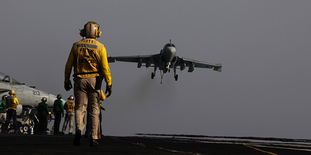 An EA-6B coming from Iraq lands on the flight deck of the U.S. Navy aircraft carrier USS George H.W. Bush on Sunday, Aug. 10, 2014 in the Persian Gulf. Aircrafts aboard the George H.W. Bush are flying missions over Iraq after U.S. President Barack Obama authorized airstrikes against Islamic militants and food drops for Iraqis trapped by the fighters.