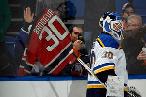 Martin Brodeur #30 of the St. Louis Blues skates in warmups prior to the game against the New York Islanders at the Nassau Veterans Memorial Coliseum on December 6, 2014 in Uniondale,