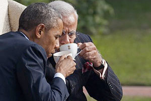 Indian Prime Minister Narendra Modi (L) talks with US President Barack Obama (R) while watching the fly-past during India's Republic Day parade on Rajpath in New Delhi on January 26, 2015. Rain failed to dampen spirits at India's Republic Day parade January 26 as Barack Obama became the first US president to attend the spectacular military and cultural display in a mark of the nations' growing closeness. AFP PHOTO/ PRAKASH SINGH