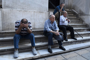 Elderly people, who usually get their pensions at the end of the month, wait outside a closed bank in the northern Greek port city of Thessaloniki, Monday, June 29, 2015. Greece's five-year financial crisis took its most dramatic turn yet, with the cabinet deciding that Greek banks would remain shut for six business days and restrictions would be imposed on cash withdrawals. (AP Photo/Giannis Papanikos)