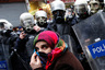A pro-Kurdish demonstrator covers her face as riot police prevent protestors from marching, at Taksim square in central Istanbul February 15, 2012. Supporters of the pro-Kurdish Peace and Democracy Party (BDP) held a protest to mark the 13th anniversary of the capture of Kurdistan Workers' Party (PKK) leader Abdullah Ocalan. REUTERS/Murad Sezer
