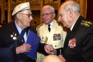 May 4, 2005 file photo of British World War II veteran, participant of Arctic convoys, Raymond Ball, left speaks with Russian veterans Anatoly Uvarov, center, and Anatoly Livshits in St.Petersburg, Russia, Dozens of British and Russian sailors of the Arctic convoys that dodged German U-boats to bring supplies to the Soviet Union during World War II gathered in St. Petersburg Wednesday to trade memories and mark the anniversary of the Allied victory of the Nazis
