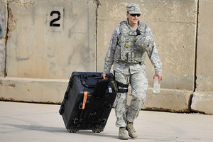 A US Army soldier begins his journey home during ceremonies marking the end of US military mission in Baghdad, Iraq, Thursday, Dec. 15, 2011. After nearly nine years, 4,500 American dead, 32,000 wounded and more than $800 billion, U.S. officials formally shut down the war in Iraq a conflict that U.S. Defense Secretary Leon Panetta said was worth the price in blood and money, as it set Iraq on a path to democracy. (AP Photo/Khalid Mohammed)