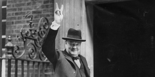 aption:Prime Minister Winston Churchill outside 10 Downing Street, gesturing his famous 'V for Victory' hand signal, June 1943. (Photo by H F Davis/Getty Images)