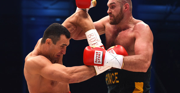 DUESSELDORF, GERMANY - NOVEMBER 28:  Tyson Fury in action with Wladimir Klitschko during the IBF IBO WBA WBO Heavyweight World Championship contest at Esprit-Arena on November 28, 2015 in Duesseldorf, Germany.  (Photo by Lars Baron/Bongarts/Getty Images)