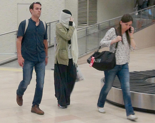 A Russian girl who was detained by Turkish security forces after getting tip off about girl's plans to pass into Syria to join Islamic state in Iraq and the Levant (ISIL) militants, at the airport on June 11, 2015 in Istanbul, Turkey. A Russian girl who was detained by Turkish security forces after receiving tip-off about girl's plan to enter Syria to join Islamic State of Iraq and the Levant (ISIL), to be deported by migration authorities. The girl named Varvara Karaulova was captured by security forces when she were trying to cross over Turkish-Syrian border via illegal ways. After being briefly subjected to necessary procedures in turkey, the girl will be sent back to Russia on Thursday evening hours. The girl had been sent back to Russia on Thursday evening hours. PHOTOGRAPH BY Cihan / Barcroft Media UK Office, Cihan / Barcroft Media