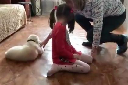 Путин подарил больной аутизмом девочке щенка