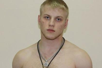 Российский полицейский-националист сел за убийство и грабежи