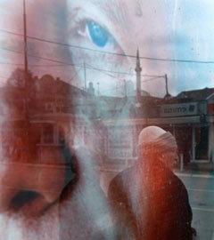 Предвыборный плакат Паколли в Приштине. Фото (c)AFP