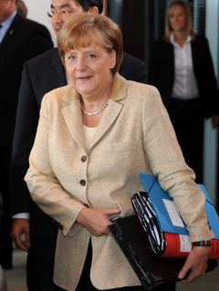 Ангела Меркель перед правительственным заседанием 6 июня. Фото AFP
