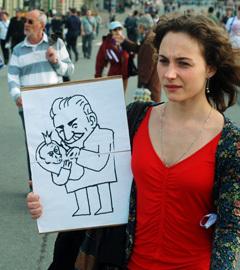 """Участница акции """"Марш миллионов"""" в Москве. Фото ИТАР-ТАСС,  Наталья Родина"""