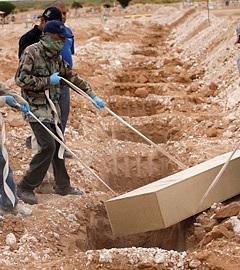 Похороны жертв разборок наркокартелей в Сьюдад-Хуаресе. Фото Reuters