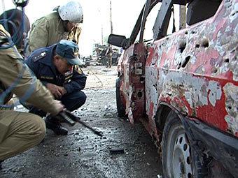 Сотрудники МЧС на месте взрыва. Фото ИТАР-ТАСС, Башир Алиев