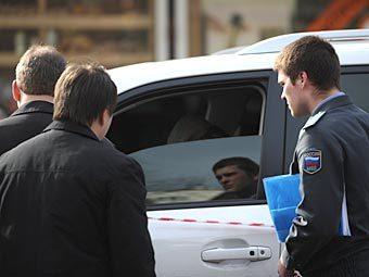 Полиция на месте убийства Ильгара Алиева. Фото РИА Новости, Григорий Сысоев
