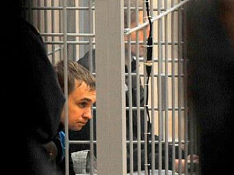Дмитрий Коновалов и Владислав Ковалев, 30 ноября 2011 года. Фото (c)AFP