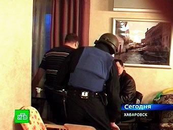 Во время задержания одного из участников банды. Кадр оперативной съемки, переданный в эфире НТВ