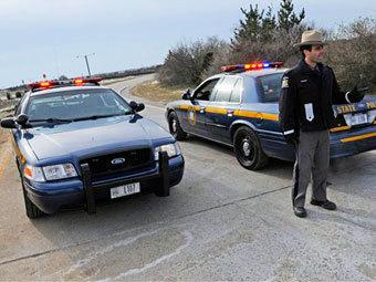 Полиция в районе поисковой операции на Лонг-Айленде. Фото (c)AP