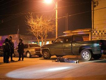 Место убийства в Сьюдад-Хуаресе. Фото (c)AFP