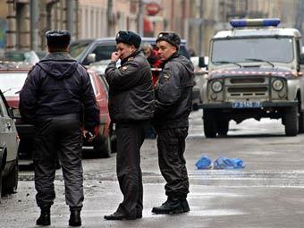 Милиция на месте преступления. Архивное фото AFP