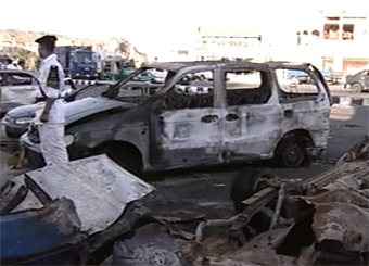 На месте одного из взрывов. Кадр Первого канала