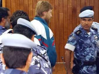 Осужденные в зале суда в Катаре, фото Reuters