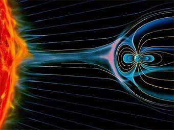 Магнитное поле Земли улавливает частицы солнечного ветра. Иллюстрация с сайта aerospaceweb.org