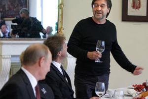 Владимир Путин, Леонид Ярмольник и Юрий Шевчук. Фото (c)AFP