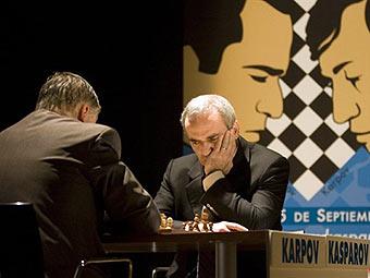 Анатолий Карпов и Гарри Каспаров. Фото (c)AFP