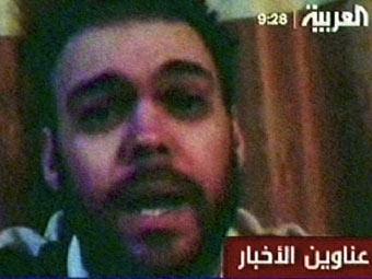 """Питер Мур во время плена. Кадр видеообращения заложника, переданный каналом """"Аль-Арабия"""""""