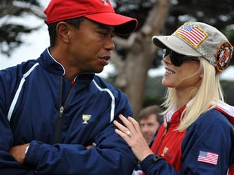 Тайгер Вудс с супругой Элин. Фото (c)AFP