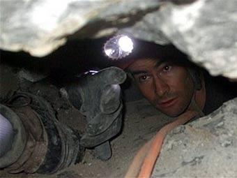 Спасатели во время поисков Джона Джоунса. Фото (c)AP