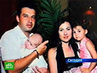 Дмитрий Ушеренко с супругой и детьми. Фото, переданное в эфире телеканала НТВ