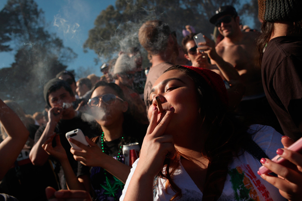 People smoke marijuana joints at 4:20 p.m. as thousands of marijuana advocates gathered at Golden Gate Park in San Francisco, California April 20, 2012. The event was held on April 20, a date corresponding with a numerical 4/20 code widely known within the cannabis subculture as a symbol for all things marijuana. REUTERS/Robert Galbraith