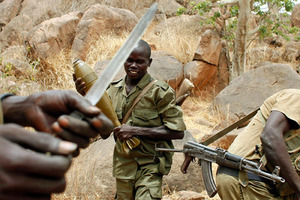 A SPLA-N fighter stands with a mortar shell near Jebel Kwo village in the rebel-held territory of the Nuba Mountains in South Kordofan, May 2, 2012. REUTERS/Goran Tomasevic
