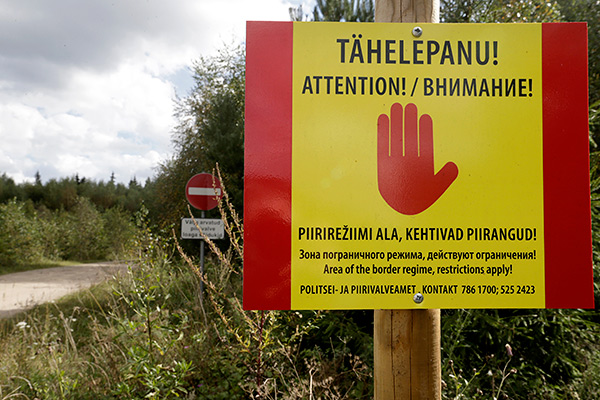 A warning sign is pictured near the Estonian-Russian border, where, according to Estonia's officials, its security officer Eston Kohver was abducted in the south-east part of country, near the village of Miikse, September 7, 2014.  Estonia said one of its security officers had been abducted on the border and taken into Russia on Friday as he tried to stop illegal activity on the border, but Russia said he had been detained on its territory as a suspected spy. Russia's Federal Security Service (FSB), successor to the Soviet KGB, said an Estonian officer, identified as Eston Kohver, had been detained on Russian territory and was being investigated.