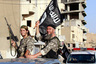 "2014Militant Islamist fighters wave flags as they take part in a military parade along the streets of Syria's northern Raqqa province June 30, 2014. The fighters held the parade to celebrate their declaration of an Islamic ""caliphate"" after the group captured territory in neighbouring Iraq, a monitoring service said. The Islamic State, an al Qaeda offshoot previously known as Islamic State in Iraq and the Levant (ISIL), posted pictures online on Sunday of people waving black flags from cars and holding guns in the air, the SITE monitoring service said. Picture taken June 30, 2014"
