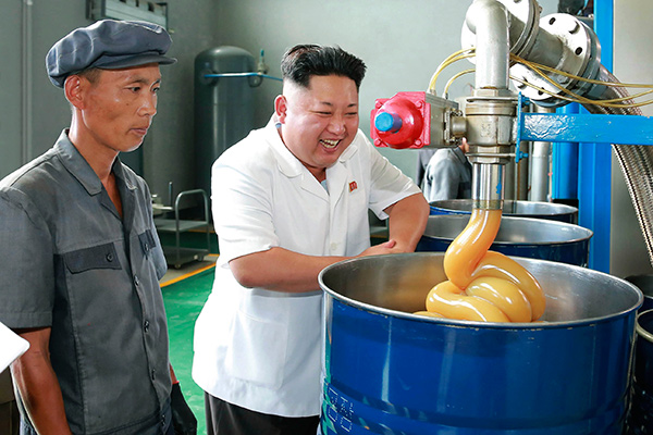 North Korean leader Kim Jong Un smiles during a visit to the Chonji Lubricant Factory, in this undated photo released by North Korea's Korean Central News Agency (KCNA) in Pyongyang August 6, 2014.