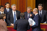 Ukrainian Prime Minister Arseny Yatseniuk (2nd R) speaks to newly appointed ministers during a parliament session in Kiev December 2, 2014. Ukraine's parliament approved in an initial round of voting on Tuesday a new government that includes foreign technocrats in key financial roles