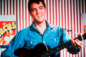 """Elvis Presley is seen as a honky-tonk performer on the midway in this photo from the 1964 MGM film """"Roustabout"""". (AP Photo"""
