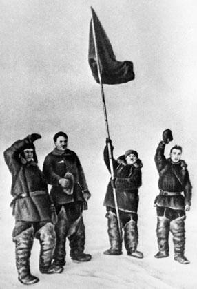 Участники экспедиции дрейфующей станции «Северный полюс - 1» устанавливают флаг СССР на Северном полюсе.