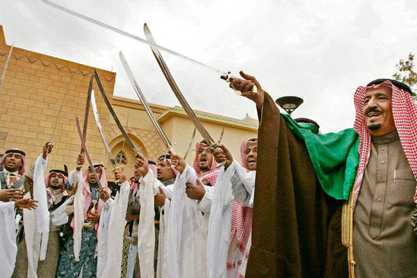 Salman bin Abdul Aziz, brother of King Abdullah (R), performs a traditional celebration dance while holding a sword outside Al Murabba Palace in Riyadh, Saudi Arabia