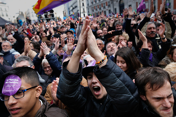 People take part in a rally called by Podemos (We Can), at Madrid's Puerta del Sol landmark January 31, 2015. Tens of thousands marched in Madrid on Saturday in the biggest show of support yet for anti-austerity party Podemos, whose surging popularity and policies have drawn comparisons with Greece's new Syriza rulers.