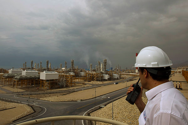 An engineer speaks on his radio at the Phase 4 and Phase 5 gas refineries in Assalouyeh, 1,000 km (621 miles) south of Tehran, January 27, 2011.  REUTERS/Caren Firouz (IRAN - Tags: ENERGY BUSINESS) - RTXX5WC