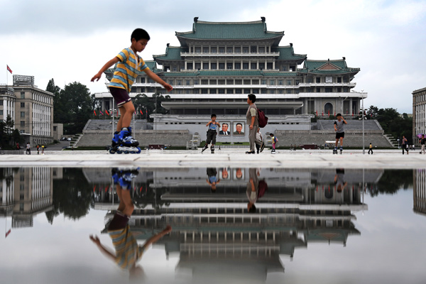 Children skate around the Kim Il Sung Square, downtown Pyongyang, North Korea. The country is preparing to mark the 60th anniversary of the end of the Korean War.