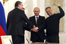 Russian President Vladimir Putin (2nd R), Crimea's Prime Minister Sergei Aksyonov (front L), Crimean parliamentary speaker Vladimir Konstantinov (back L) and Sevastopol Mayor Alexei Chaliy shake hands after a signing ceremony at the Kremlin in Moscow March 18, 2014.