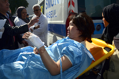A victim arrives at the Charles Nicoles hospital, Wednesday, March 18, 2015 in Tunis, Tunisia. Authorities say scores of people are dead after an attack on a major museum in the Tunisian capital, and some of the gunmen may have escaped. (AP Photo/Edel Ezine)
