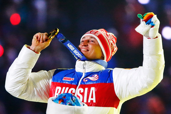 Russian gold medalist Alexander Legkov celebrates as he recieves his medal for the men's cross-country 50-kilometer mass start race during the closing ceremony for the Sochi 2014 Winter Olympics, February 23, 2014.
