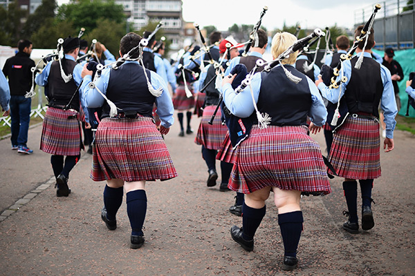 GLASGOW, SCOTLAND - AUGUST 15:  Dowco Triumph Street pipe band from Vancouver take part in 2014 World Pipe Band Championships grade one qualifiers at Glasgow Green on August 15, 2014 in Glasgow, Scotland. The annual World Pipe Band Championships has returned to Glasgow this weekend, with a programme that will have 300 performances from 223 pipe bands competing for the title.