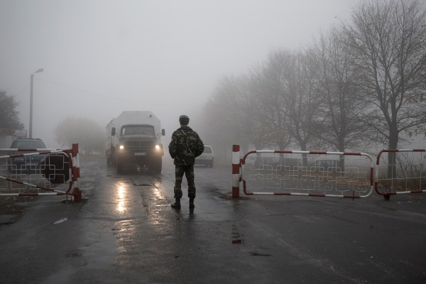 A russian army check point at the road between Chisinau and Tiraspol on 10 November 2009 ,Tiraspol is the capital and administrative centre of the de facto independent Pridnestrovian Moldavian Republic (Transnistria). The city is located on the eastern bank of the Dniester River.Transnistria is a disputed region in Eastern Europe, located mostly in a strip between the Dniester River and Ukraine. Since its declaration of independence in 1990, and especially after the War of Transnistria in 1992, it is governed by the unrecognized Pridnestrovian Moldavian Republic (PMR), which claims the left bank of the river Dniester and the city of Bender within the former Moldavian SSR. Russian military contingent is present in Transnistria. The status of this contingent is disputed. The 1992 cease-fire agreement between Moldova and Transnistria established a Russian peace-keeper presence in Transnistria. Russian troops stationed in Moldova proper since the time of the USSR were fully withdrawn to Russia by January 1993.