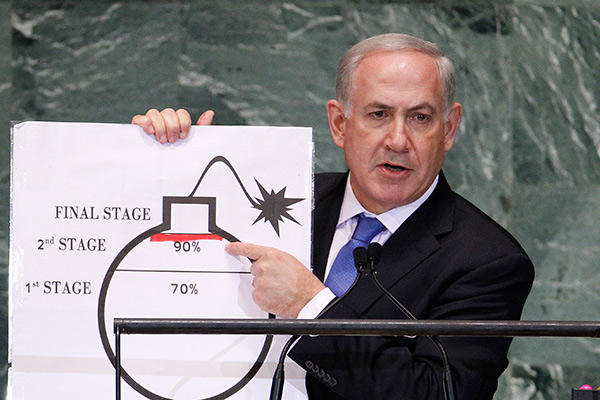 srael's Prime Minister Benjamin Netanyahu points to a red line he has drawn on the graphic of a bomb as he addresses the 67th United Nations General Assembly at the U.N. Headquarters in New York, September 27, 2012. REUTERS/Lucas Jackson